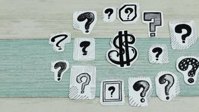 Dollar in questions scroll. The sketch of the dollar sing among question marks stock footage