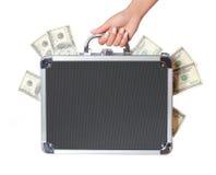 Dollar räkningar i fall att i den isolerade kvinnliga handen, pengar i resväska fotografering för bildbyråer