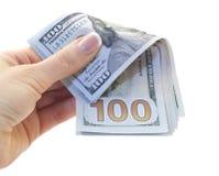 100 dollar räkningar i hand Arkivbild