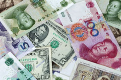 Dollar and RMB. Bills of USD and RMB Stock Images
