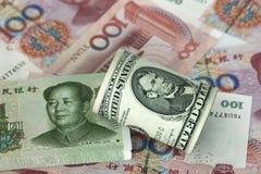 Dollar and RMB. Bills of USD and RMB Royalty Free Stock Photos
