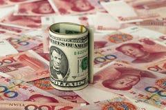 Dollar and RMB. Bills of USD and RMB Royalty Free Stock Image
