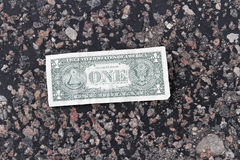 Dollar on the road. Royalty Free Stock Photo