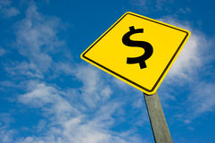 Dollar on road sign. Dollar symbol on a yellow traffic sign royalty free stock images