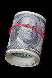 Dollar roll on black Royalty Free Stock Photo