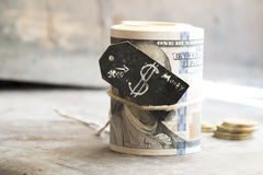 Dollar roll and coins Stock Photography