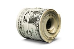 Dollar roll tightened with band. Rolled money royalty free stock photos