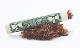 Dollar roll tobacco joint on white Royalty Free Stock Images