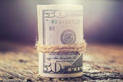 Dollar rollten Banknotennahaufnahme Bargeld-Amerikaner-Dollar Cl stockbilder