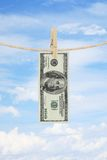 Dollar on rope Royalty Free Stock Photo