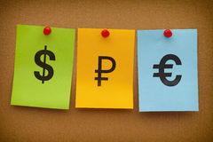 Dollar-, rubel- och eurotecken Arkivfoton