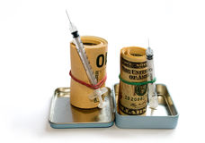 dollar rullar injektionssprutan Royaltyfria Bilder