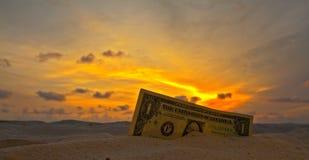 Dollar's sunset. One dollar on a sunset stock photo