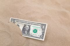 Dollar in the sand horizontal. Royalty Free Stock Image