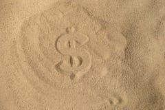 Dollar-Schattenbild auf dem Sand stockbilder