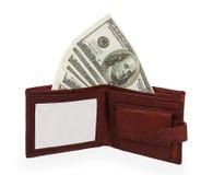 100 dollar sedel i öppen brun läderhandväska Royaltyfri Foto