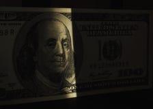 Dollar in shadow as symbol of hidden profits Stock Photos
