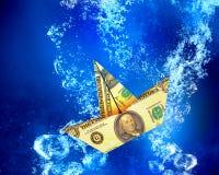 Dollar ship under water Stock Photos