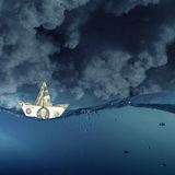 Dollar ship in water Royalty Free Stock Images