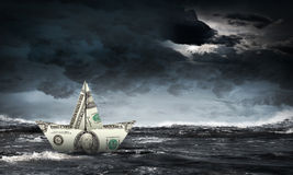 Dollar ship in water Royalty Free Stock Photo