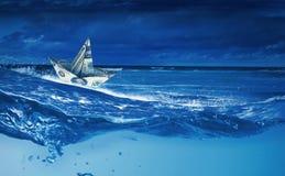 Dollar ship in water Stock Photos