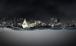 Dollar ship in water Royalty Free Stock Photo