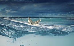 Dollar ship in water Stock Photo