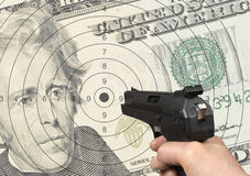 Dollar shooting Royalty Free Stock Images