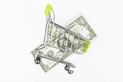 Dollar in the shopping cart. Royalty Free Stock Images