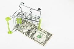 Dollar in the shopping cart. Stock Photos