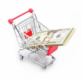 Dollar in shopping cart Stock Photography