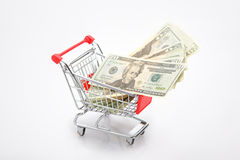 Dollar in shopping cart Stock Images