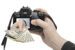 Dollar Shot. A hand reaches out of a digital camera Royalty Free Stock Photography