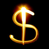 Dollar sign. Created by light over black background stock photography