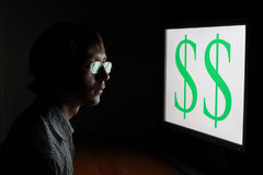 Dollar sign. Man looking on dollar sign on monitor royalty free stock images