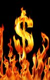 Dollar sign. Shapped fire flame over black background Royalty Free Stock Images