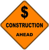 Dollar Sign. With \Construction Ahead\ in an orange triangular street driving warning sign Stock Photography