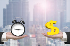 Dollar sign and alarm clock with two hands Stock Photography