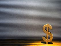 Dollar sign background. Dollar sign made of wood on a gray background Stock Photos