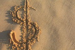 Dollar sign on the beach Royalty Free Stock Image
