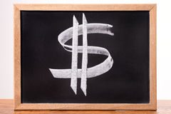 Dollar sign on a blackboard Stock Photos