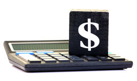 Dollar sign and calculator Stock Image