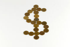 Dollar sign drawn with coins Stock Photos