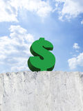 Dollar sign on edge of cliff Stock Image