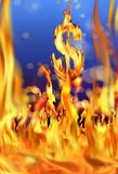 Dollar sign and fire flames. Conceptual image of burning dollar sign and fire flames Royalty Free Stock Images