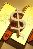 Dollar sign on gold bars Royalty Free Stock Image