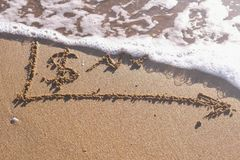 Dollar sign and growth chart written in the sea sand. Waves washed away the inscription. Dollar sign and growth chart written in the sea sand. Waves washed away royalty free stock photos