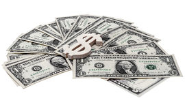Dollar sign lying on the bills Royalty Free Stock Photo
