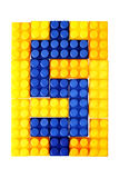 Dollar sign made from building block of meccano Royalty Free Stock Images