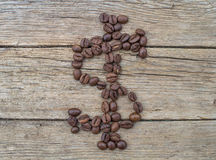 Dollar sign made of coffee beans Stock Image
